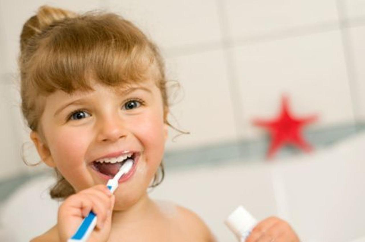 Baby brushing her teeth